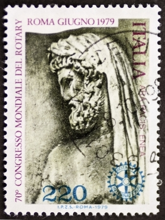 ITALY – CIRCA 1979: a stamp printed in Italy celebrates World Rotary congress in Rome showing an image of Aeneas drawn from Ara Pacis. Italy, circa 1979 Stock Photo - 21844268