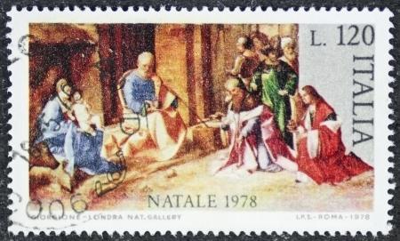 bethlehem crib: ITALY – CIRCA 1978: a stamp printed in Italy celebrates Christmas showing a nativity scene. Italy, circa 1978