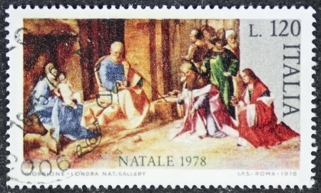 ITALY � CIRCA 1978: a stamp printed in Italy celebrates Christmas showing a nativity scene. Italy, circa 1978