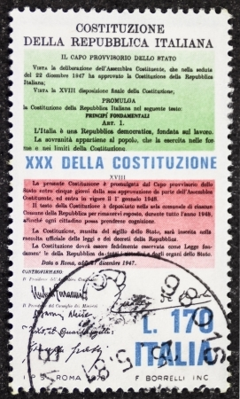 lawmaking: ITALY � CIRCA 1978: a stamp printed in Italy celebrates Constitution of Italy showing initial and final articles of it. Italy, circa 1978 Editorial