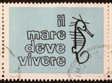 promotes: ITALY – CIRCA 1978: a stamp printed in Italy promotes the preservation of marine environment showing a seahorse image and the motto Il Mare Deve Vivere (Sea Must Live). Italy, circa 1978