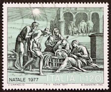 ITALY  CIRCA 1977: a stamp printed in Italy celebrates Christmas showing a nativity scene. Italy, circa 1977