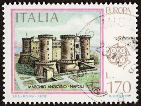ITALY CIRCA 1978: a stamp printed in Italy shows illustration of Maschio Angioino castle, medieval edifice in Naples, southern Italy. Italy, circa 1978