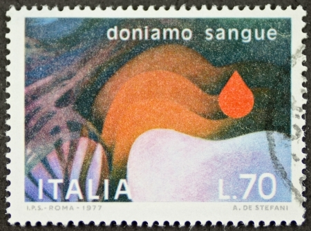 promotes: ITALY CIRCA 1977: a stamp printed in Italy promotes blood donation. Italy, circa 1977