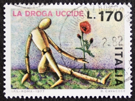 opium poppy: ITALY CIRCA 1977: a stamp printed in Italy promote a campaign against drugs and addiction. Italy, circa 1977