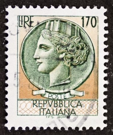 allegoric: ITALY - CIRCA 1977: a stamp printed in Italy shows  head of Italia Turrita (Italy with towers), national personification and allegory of Italy. Italy, circa 1977