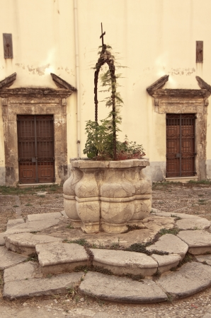 sicily: Old stone well in the courtyard of Gancia convent, Palermo, Sicily Stock Photo