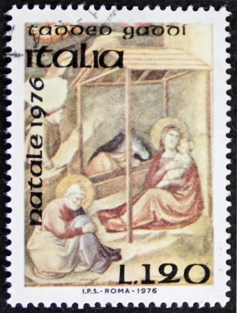 ITALY CIRCA 1976: a stamp printed in Italy celebrates Christmas showing a nativity scene by Taddeo Gaddi (ca. 1290 - 1366), medieval Italian painter and architect in Florence. Italy, circa 1976