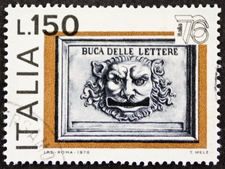 ITALY CIRCA 1976: a stamp printed in Italy celebrates Expo Italy showing image of an old postbox face shaped. Italy, circa 1976 Editorial