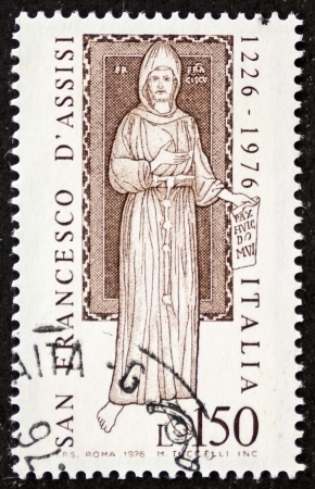 st  francis: ITALY CIRCA 1976: a stamp printed in Italy celebrates San Francesco dAssisi (Saint Francis of Assisi ca.1181 -1226). Italy, circa 1976