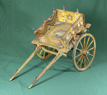 folkloristic: Old small sicilian cart on green background