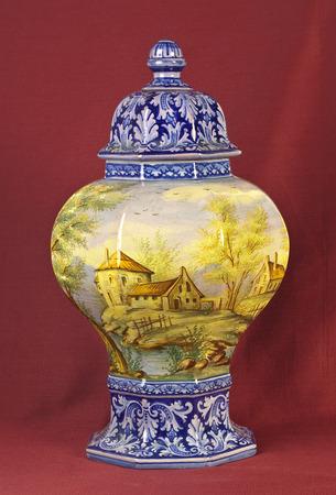 oxblood: Old porcelain vase om oxblood red background