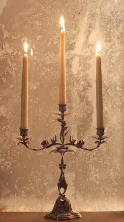 candelabrum: Antique candelabrum with lighted candles