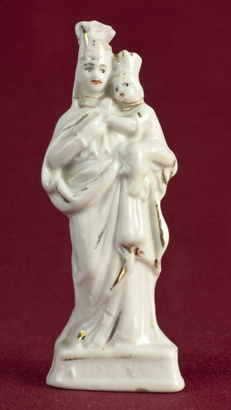 oxblood: Mary and Jesus porcelain  statuette on oxblood red background