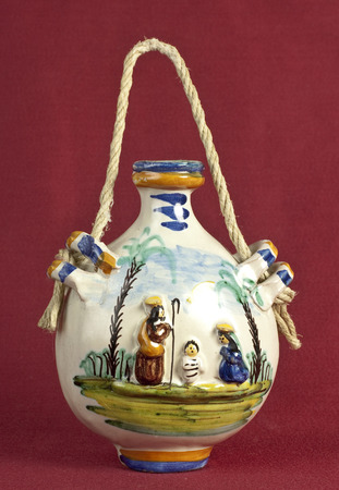 holy jug: Holy family decoration on ceramic flask