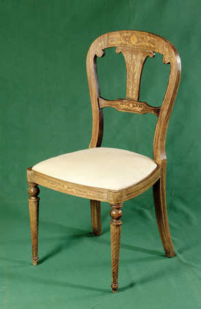 antique chair: Antique chair on green background Stock Photo