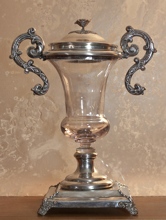 Old crystal and silver vase, cup shaped photo