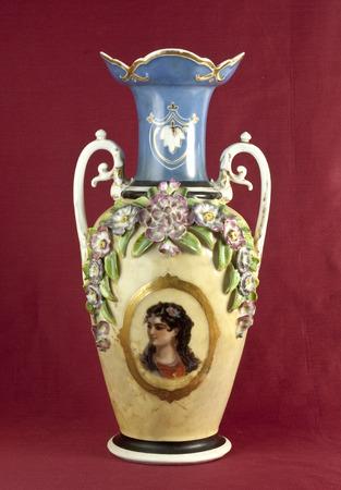 oxblood: Old porcelain vase on oxblood red background