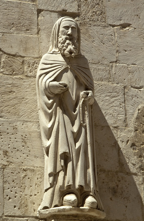 cleric: Ancient cleric statue on the side facade of Santa Maria Maggiore church, Caramanico Terme, Abruzzo region, Italy Stock Photo
