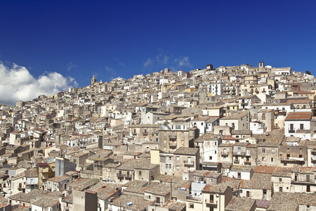 town houses: View of houses in Prizzi, small town on a hillside, Sicily