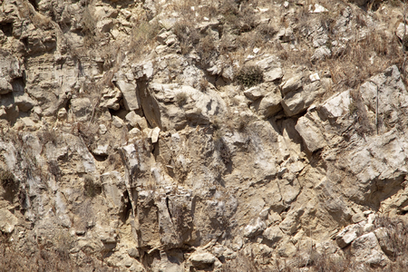 abrupt: Sunburnt rocks in Sicilian countryside. It may be used as a background