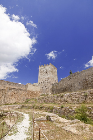saint nicholas: View of Lombardy Castle: footpath in Saint Nicholas courtyard and Torre Pisana (Pisana tower). Enna, Sicily
