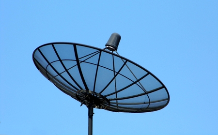 frequencies: Satellite dish with blue sky