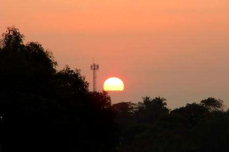 dawning: Sunset with telecommunication antenna tower
