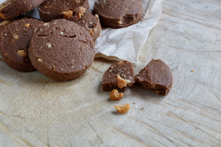 cashews: Chocolate cookie with Cashews on wooden background