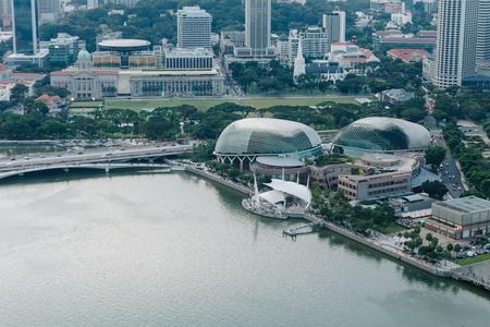 SINGAPORE - APRIL 14, 2017 : Esplanade Theatre view on Anderson Bridge, foreground is Singapore river and esplanade drive, in background are skyscraper. Editorial