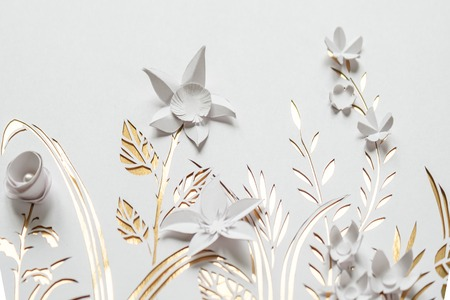 Summer flowering meadow. White flowers carved from paper on a white and gold background. Cut of paper Stock Photo - 78193876
