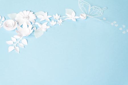 frame with white paper flowers on blue background