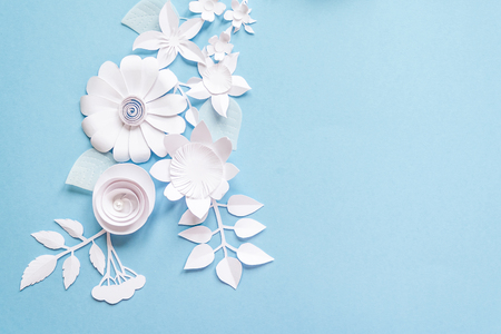 frame with white paper flowers on blue background Stok Fotoğraf - 78193923