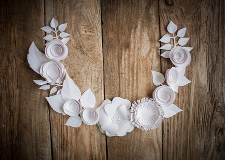 Paper flowers on wood background in the form of a semicircle Stock Photo