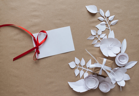 Small paper flowers and leaves and gift white csrd stock photo small paper flowers and leaves and gift white csrd stock photo 78241691 mightylinksfo