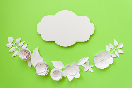 Vintage frame semicircle frame with white paper flowers on the stock photo vintage frame semicircle frame with white paper flowers on the green background flat lay nature concept cut from paper mightylinksfo