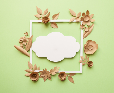 Square frame with craft paper flowers on the green background square frame with craft paper flowers on the green background flat lay nature concept mightylinksfo