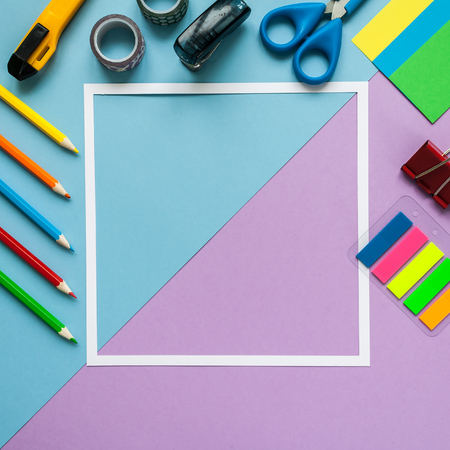 study group: Back to school, square frame with stationery on blue and violet background. flat lay. Stock Photo