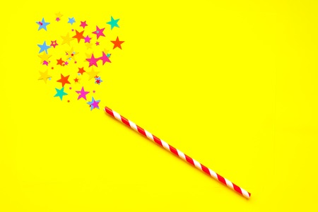 magic wand with glittering star on yellow background Stock Photo