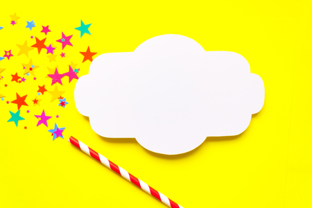 frame with magic wand with glittering star on yellow background