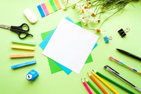 Back to school. square frame. Green leaves on color green background Stock Photo