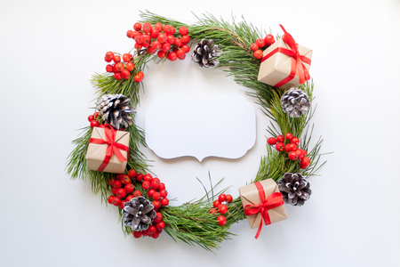 pinecones: Merry Christmas and Happy new year. Round frame with branches firtree, gifts, pine cones and red berries Stock Photo