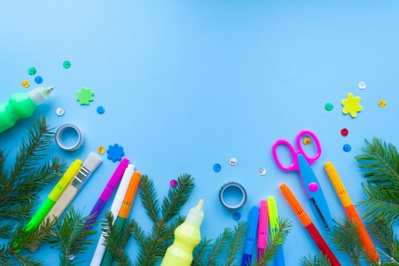 Christmas and new year, stationery, surrounded by fir branches on blue background Stock Photo