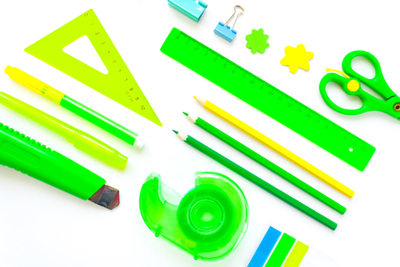 green and yellow stationery on white background. flat lay. Stock Photo