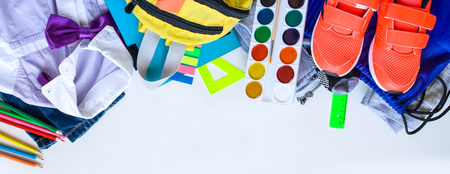 school fees, colorful pencils scissors on white background, space for text, flat lay, back to school concept, first day of school
