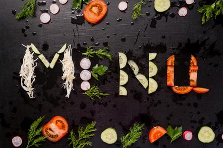 The inscription menu, made with sliced vegetables. Menu concept