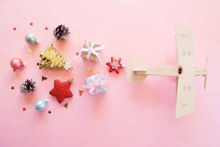 wooden childrens plane on a pink background