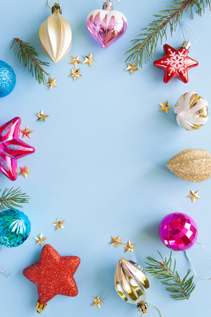 Frame of various Christmas toys on a blue background