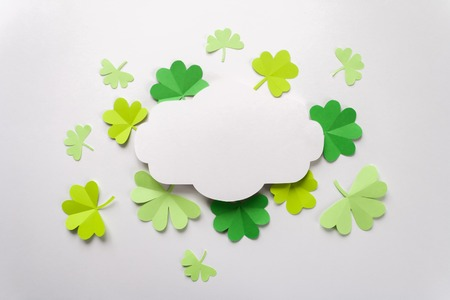 Happy St.Patrick's Day, freme with shamrock cut from paper on white background, text greeting card raster