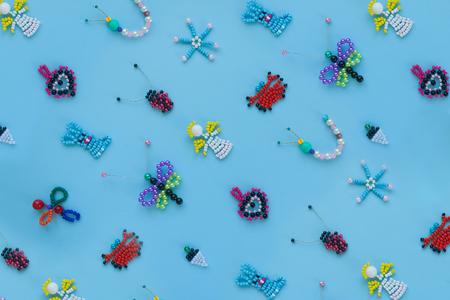 pattern of childrens crafts on a blue background. Childrens creativity, handmade